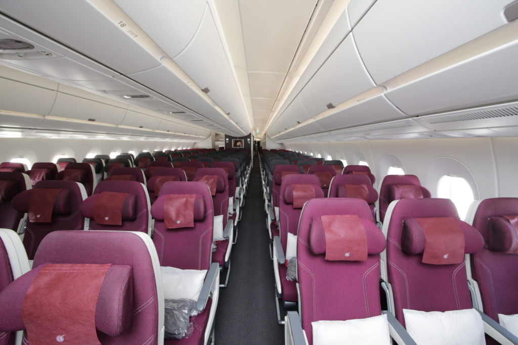 An empty Qatar Airline cabin.